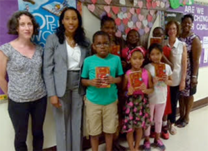 (L to R) Nicole Guenkel, Head of Youth Services at PPLD Dr. Nicole Williams, Superintendent of Poughkeepsie City Schools Warring Academy 3rd Graders with their new books Jode Millman, Millman Harris Romano Foundation Nadine Dargan, Principal of Warring Academy Photo by: Jewel Ratzlaff, PPLD Staff